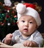 Christmas baby. Asian christmas baby looking at camera Royalty Free Stock Image