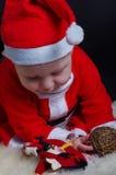 Christmas Baby on black background Stock Photo
