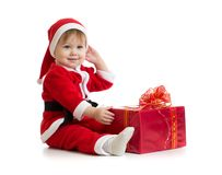 Christmas baby with box in Santa's clothes Royalty Free Stock Images