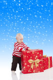 Christmas baby boy with gift box, Royalty Free Stock Photo