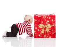 Christmas baby boy with gift box, Royalty Free Stock Photography