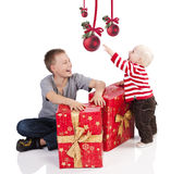 Christmas baby boy with gift box with brother Stock Photo
