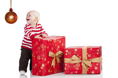 Christmas baby boy with gift box, he is standing Royalty Free Stock Images