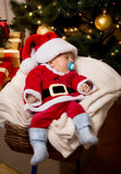 Christmas baby boy sleeping in basket at living room Royalty Free Stock Image