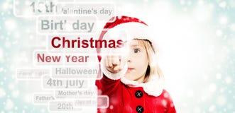 Christmas Baby choosing a Christmas. Christmas Child Royalty Free Stock Photo