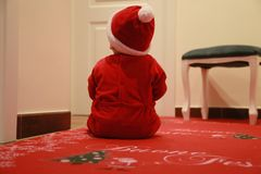 Christmas baby. On red carpet Royalty Free Stock Image