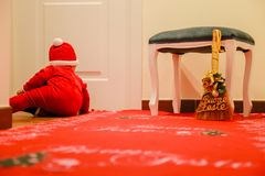 Christmas baby. On red carpet lying down Royalty Free Stock Images