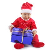 Christmas baby with gift. On white background Royalty Free Stock Images