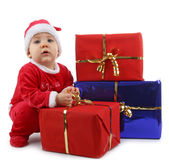 Christmas baby and gift. Isolated christmas baby and gifts boxes Royalty Free Stock Photo