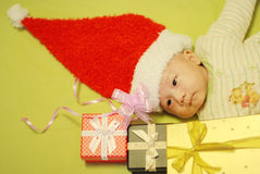 Christmas baby and  gifts Royalty Free Stock Photography