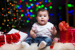 Christmas baby with gifts. Christmas baby girl with gifts stock images