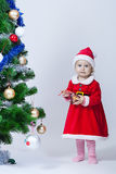 Christmas baby girl in a cap of Santa Claus Royalty Free Stock Photo