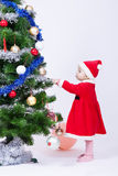 Christmas baby girl in a cap of Santa Claus Royalty Free Stock Photos