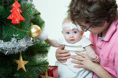 Christmas baby girl with father Stock Images