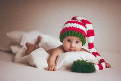 Christmas baby girl newborn in hat. Christmas baby girl newborn in new year hat royalty free stock images