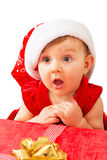 Christmas baby girl and present Royalty Free Stock Photography