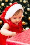 Christmas baby girl and present Stock Photography
