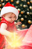 Christmas baby girl and present Stock Photo