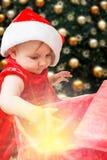 Christmas baby girl and present Stock Photo