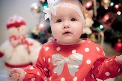 Christmas baby girl. Smiling near christmas tree Stock Image