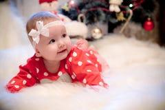 Christmas baby girl. Smiling near christmas tree Royalty Free Stock Photos