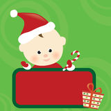 Christmas baby holding sign Royalty Free Stock Photo