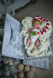 Christmas baby, the New Year, gifts, the Christmas tree Royalty Free Stock Photography