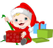 Christmas baby open gift Royalty Free Stock Images