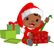 Christmas baby open gift Stock Photo