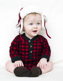 Christmas baby with red shirt and hat. Happy Christmas baby with red plaid shirt, furry, fleece plaid hat with brown boats isolated on white Stock Photos