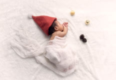 Christmas Baby in Santa Hat,Asian baby  in Christmas hat sleeps Stock Image