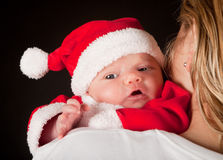Christmas baby in santa suit Stock Photo