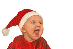 Christmas baby shrieking. Cute baby in Christmas hat and clothing shrieking joyfully stock images