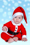 Christmas baby sitting Royalty Free Stock Image