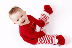 Christmas baby sitting and laughing Royalty Free Stock Image