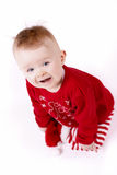 Christmas baby sitting and laughing Royalty Free Stock Images