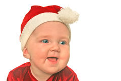 Christmas baby smiling. Cute baby in Christmas hat and clothing stock photo
