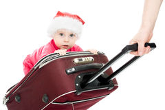 Christmas baby in the suitcase. On a white background Royalty Free Stock Images