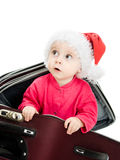 Christmas baby in the suitcase Stock Images