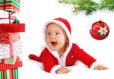 Christmas baby unders a tree with gifts Royalty Free Stock Photography