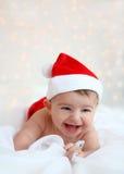 Christmas baby wearing Santa hat Royalty Free Stock Image