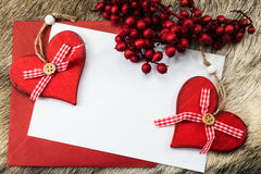 Christmas backgound with red hearts. Red and white letter with space for text Stock Photos