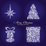 Christmas background 10. Christmas card with fir tree, star, gift box and bell made from silver snowflakes, Christmas decorations on blue background and a wish Stock Image