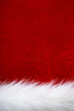 Christmas background. Red velvet and white fur. Part of Santa' s clothing Stock Photos