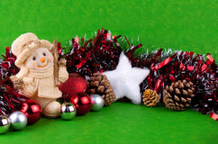Christmas background. Snowman, christmas balls and white snowstar on green background Stock Image