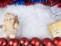Christmas background. Snowman, christmas balls and boxes on snow Royalty Free Stock Image