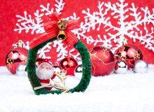 Christmas background. Xmas coronet on snow with xmas balls in background Royalty Free Stock Images