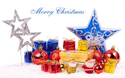 Christmas background. Xmas stars, gifts, balls on snow with text merry christmas Stock Photos