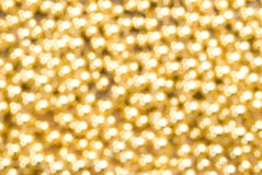 Christmas background. Gold christmas shining balls texture. Out of focus Stock Photography