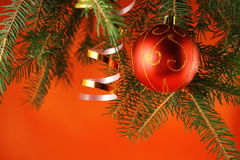 Christmas background. With a bauble and a handbell Royalty Free Stock Photography